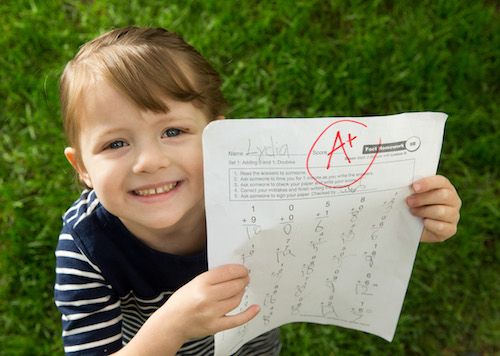 1505-42 039 1505-42 Schoolchild Illustration Photo Illustration of grade school child proudly displaying her grade to a parent. May 18, 2015 Photo Illustration by Jaren Wilkey/BYU © BYU PHOTO 2015 All Rights Reserved photo@byu.edu  (801)422-7322